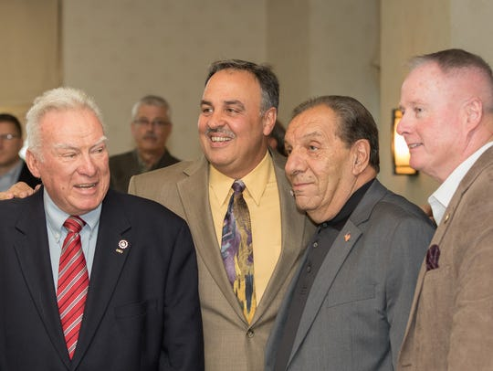 From left, Tim Connolly Sr., retired NYPD; Louis Falco