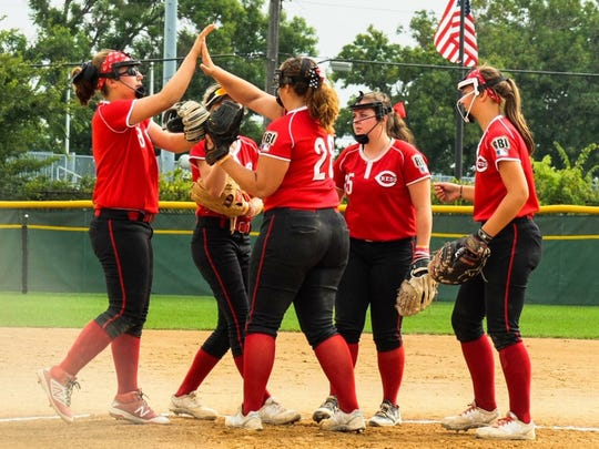 Bailey Garcia of Oak Hills celebrates an out in the pitching circle for the Cincinnati Reds RBI softball team