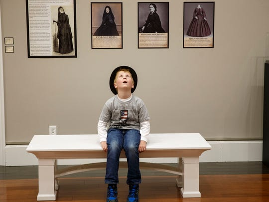 Eight-year-old Garrett Dennis of Kentucky wears a top hat as he looks around at an exhibit of Victorian mourning customs at the Springfield Art Association, May 1, 2015. Dennis and his family were in town from northern Kentucky for the 150th anniversary of Abraham Lincoln's funeral.