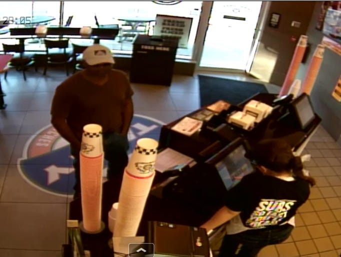 Surveillance captured images of the armed robbery suspect.