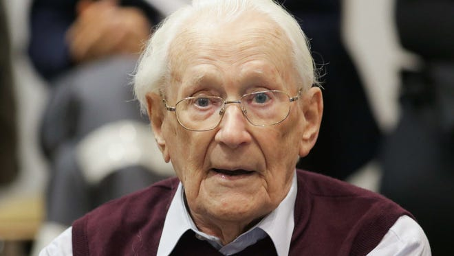 Former Nazi SS officer Oskar Groening listens to the verdict of his trial on July 15, 2015, at court in Lueneburg, northern Germany.