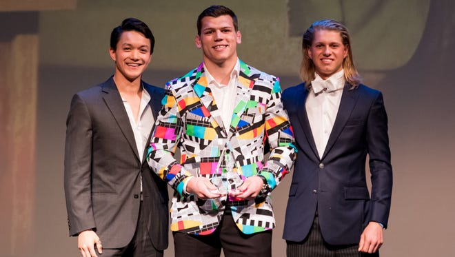 Jacob Kasper's award as Duke Athletics MVP gets lost in the bold colors of his sportcoat.