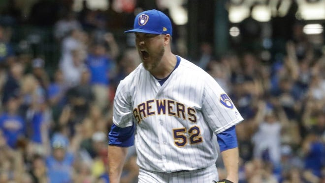 Starting pitcher Jimmy Nelson is pumped after the Brewers turned a double play to end the top of the eighth inning against the Dodgers on Friday.