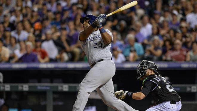 Jesus Aguilar launches a two-run homer to straightaway center with two outs in the top of the ninth inning to break a 3-3 tie for the Brewers in their victory over the host Rockies on Saturday night.