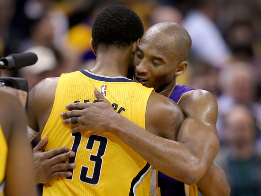Indiana Pacers forward Paul George (13) give a hug