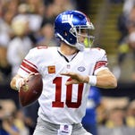 New York Giants quarterback Eli Manning (10) makes a pass during the second quarter of the game against the New Orleans Saints at the Mercedes-Benz Superdome.