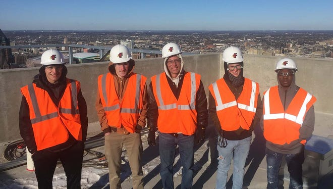 On top of Northwestern Mutual, from left: Kolten Sabel; Ben Baker; Vern Widmer, CCA instructor; Jordan Payne; and Dalvin Gryer.