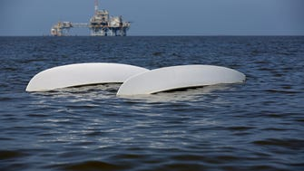 A capsized catamaran drifts in the water off Dauphin Island, Ala., on April 26.