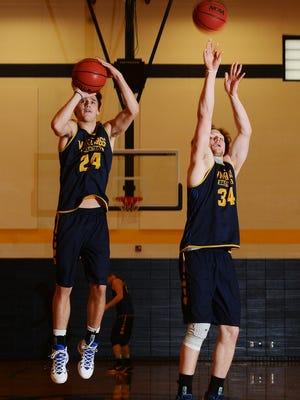 Augustana University basketball players, Steven Schaefer and Daniel Jansen demonstrate their three point shooting stances before practice Wednesday, Jan 6, 2016.