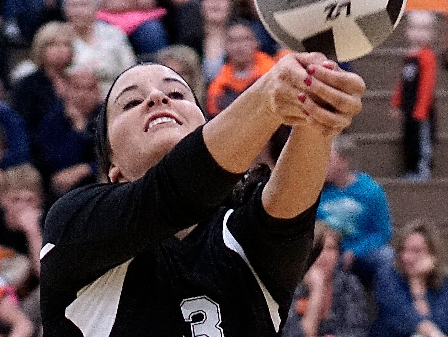 Lucas' Makayla Strassell tries to save a errant bump during their game Tuesday against Mansfield Christian.