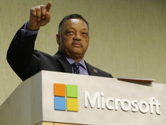 Jesse Jackson addresses Microsoft executives, one of