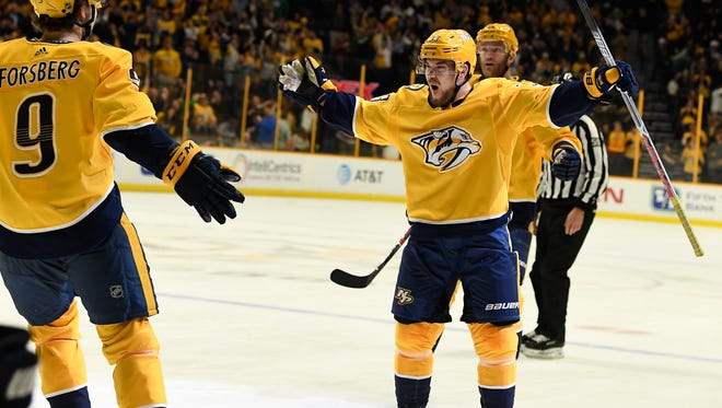 Predators right wing Viktor Arvidsson (33) celebrates his goal with left wing Filip Forsberg (9) during the first period of their game against the Jets at Bridgestone Arena Tuesday, March 13, 2018 in Nashville, Tenn.
