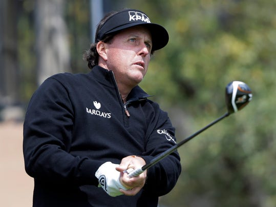 Phil Mickelson watches his tee shot as he takes part in a pro-am at the Valero Texas Open, Wednesday, March 26, 2014, in San Antonio. Mickelson is straying from his usual schedule and playing in the Valero Texas Open for the first time in 22 years. (AP Photo/Eric Gay)