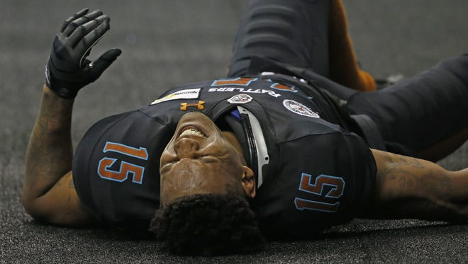 Rattlers' Kerry Reed lays on the ground injured after a play against the Steel at Talking Stick Resort Arena on April 30, 2016 in Phoenix, Ariz.