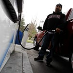 A customer pumps gas at a Chevron gas station in Mountain View, Calif.