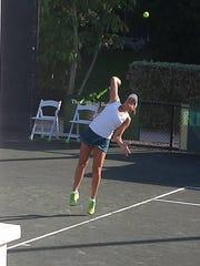 Jennifer Brady serves to opponent Anna Tatishvili in semifinals round.