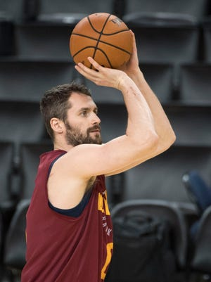 Kevin Love shoots the basketball during NBA Finals media day at Oracle Arena.
