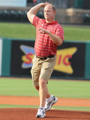 WKU football coach Jeff Brohm threw out the first pitch before Monday's Louisville Bats game