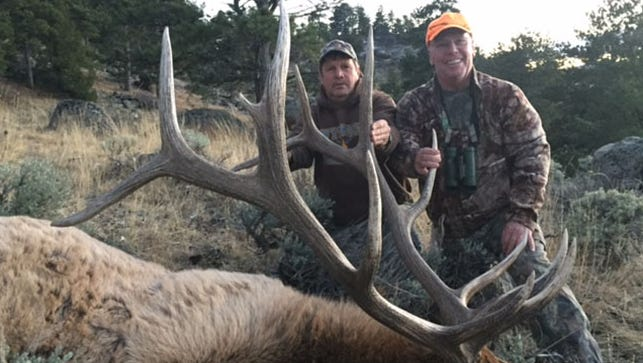 Red Lion's Kevin Fenimore, right, harvested a bull elk that scored 356 during his hunting trip to the Medicine Bow National Forest in Wyoming.