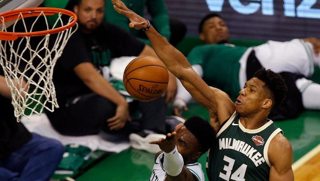 epa06699906 Milwaukee Bucks forward Giannis Antetokounmpo (R) of Greece blocks the shot of Boston Celtics guard Jaylen Brown (L) during the first quarter of the NBA Eastern Conference First Round playoff basketball game seven between the Boston Celtics and the Milwaukee Bucks at the TD Garden in Boston, Massachusetts, USA, 28 April 2018.  EPA-EFE/CJ GUNTHER  SHUTTERSTOCK OUT