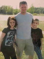 "Kurt Mills, middle, and his children, Hannah Mills and Dylan Mills pose by the water in 2010. ""This picture is especially emotional for me because it is the beginning of several years of extreme parental alienation (child abuse),"" Kurt Mills said.. ""This is before any real long term damage had been done."""