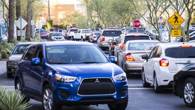 Cars packed the Tempe Marketplace parking lot during the second busiest shopping day of the year on Saturday, Dec. 19, 2015 in Tempe.