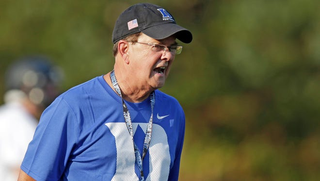 In this photo taken Wednesday, Aug. 5, 2015, Duke coach David Cutcliffe directs his team during an NCAA college football practice in Durham, N.C.