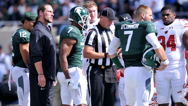 Spartan linebacker Riley Bullough, left, was in street clothes during Saturday's game.