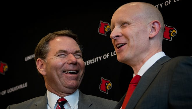 Athletic Director Vince Trya, (center) and newly appointed head coach of men's basketball team, Chris Mack, speak after a press conference at the Yum Center in Louisville, Ky, March 28, 2018.