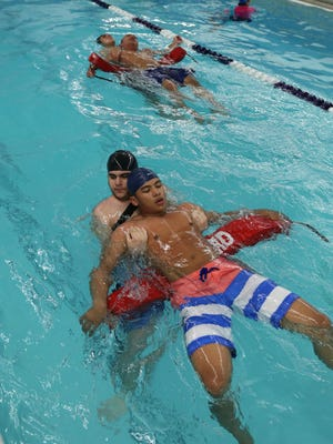 Lifeguards Johnny Justiniano and Kalvin Almonte train under the direction of Shantell Jackson, the Aquatics Director (not pictured) at the Yonkers YMCA.