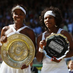 Venus, right, consoles her defeated sister, Serena, after their match in 2000 semifinals.