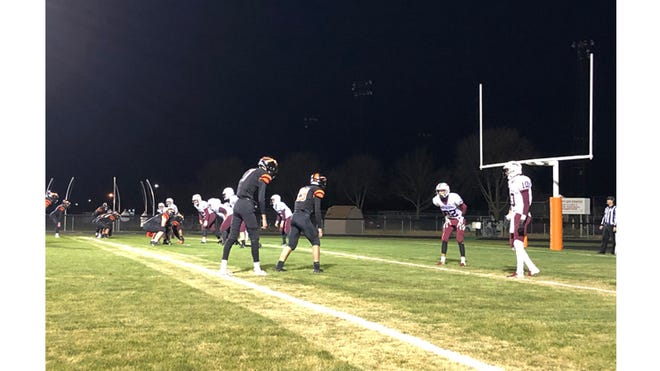 The Iindians' offense gets set before its first touchdown of the game against Cathedral on Oct. 16. The Indians scored on a five-yard run by Mason Sellner.