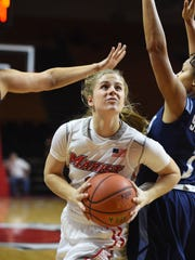 Marist College's Claire Oberdorf drives to the basket around Saint Peter's Rebecca Sparks during Monday's game at Marist.
