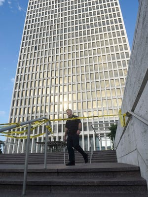 Police investigate a body found in the courtyard of the William R. Snodgrass Tennessee Tower earlyThursday morning July 14, 2016 in Nashville, Tenn.