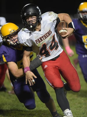 Hagerstown's Jake Combs tackles Knightstown's Jon Simmons during a football sectional game Friday, Oct. 28, 2016 in Hagerstown.