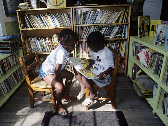 Young Students Reading in One-Room Schoolhouse