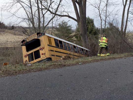 Augusta County bus 83 in a ditch after hitting a pothole