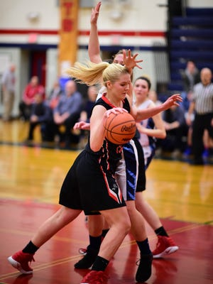 Livonia Churchill's Annie Yost works her way into the low post during Wednesday's district game against Livonia Stevenson.