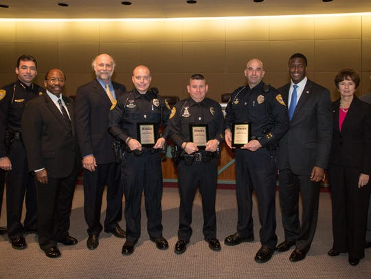 TPD Officers Wayne Staats, Scott Angulo, and Mark Lewis (in center, left to right), were among the winners of the 2014 Tallahassee Democrat Person of the Year award.
