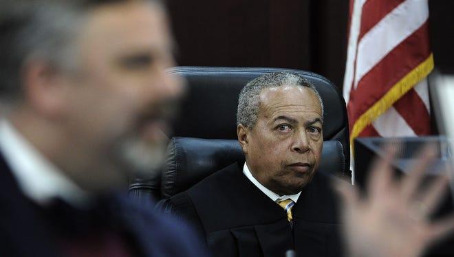 Judge Monte Watkins listens to attorney Fletcher Long's final argument during day 12 of the Vanderbilt rape trial on Tuesday in Nashville.