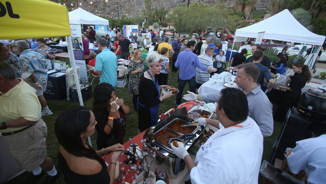 """Local restaurants and other businesses make presentations at the Palm Springs Chamber of Commerce Business Expo and Taste of Palm Springs on Tuesday at the Colony 29 events and vacation rental space. The Palm Springs Chamber of Commerce Business Expo & Taste of Palm Springs  featured numerous local businesses and restaurants with booths and other information in Palm Springs on September 30, 2014 at """"The Colony""""."""