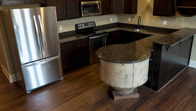 A mixing bowl, left behind from Smith's Bakery, has been built into the kitchen counter in one of the new Midtown Lofts. The Midtown Loft building, located at 411 Grand River Ave. in downtown Port Huron, has housed machinery dealers, restaurants and bars, a beauty and barber shop, an antique store and more since being constructed sometime between 1911 and 1914.