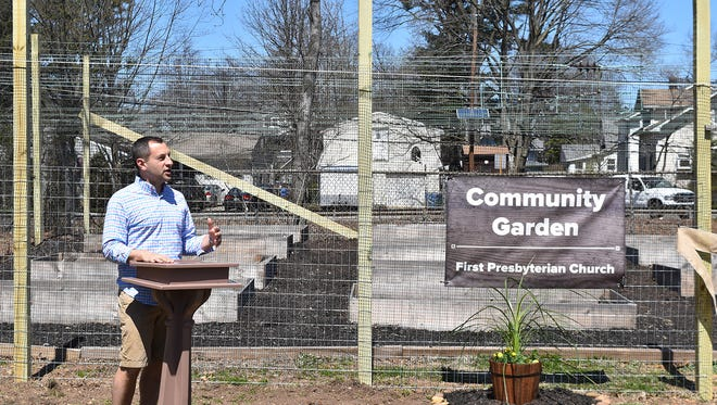 Metuchen Mayor Jonathan Busch spoke at the April 22 opening ceremonies for the new Community Garden opened at the First Presbyterian Church of Metuchen.