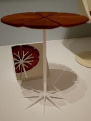 """The Knoll """"Petal"""" end table designed by Richard Schultz, set up in the gallery at the Perelman building with a mirror to show all angles."""