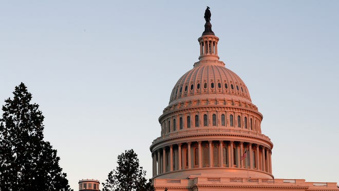 In this Nov. 18, 2016, photo, the U.S. Capitol dome is seen at sunset.