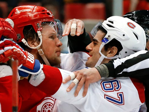 Red Wings left wing Justin Abdelkader (8) and Canadiens