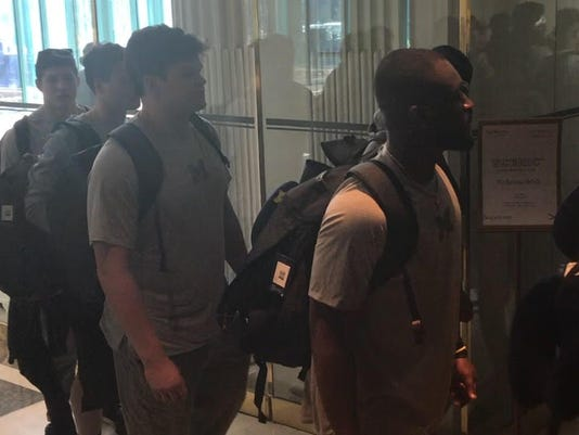Michigan football arrives in Paris