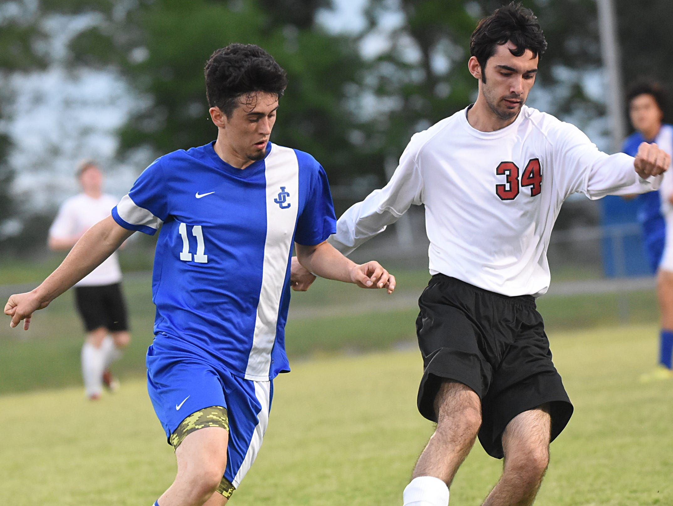 Westmoreland High senior defender Landon Graves maintains possession during the second half amidst pressure from Jackson County senior Dylan Penley.
