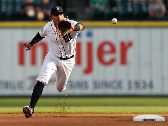 Tigers second baseman Dixon Machado (49) fields a hit during the first inning Friday at Comerica Park.
