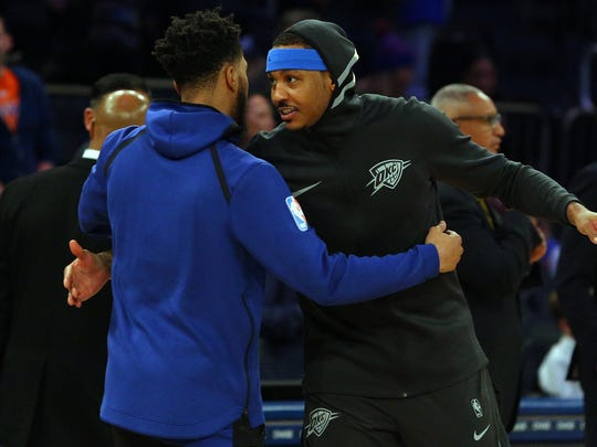 Oklahoma City Thunder power forward Carmelo Anthony (7) hugs New York Knicks shooting guard Courtney Lee (5) before a game at Madison Square Garden on Saturday, Dec. 16, 2017.